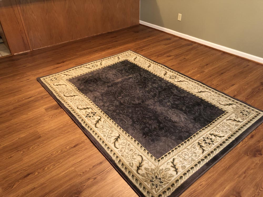 hardwood floor with rug