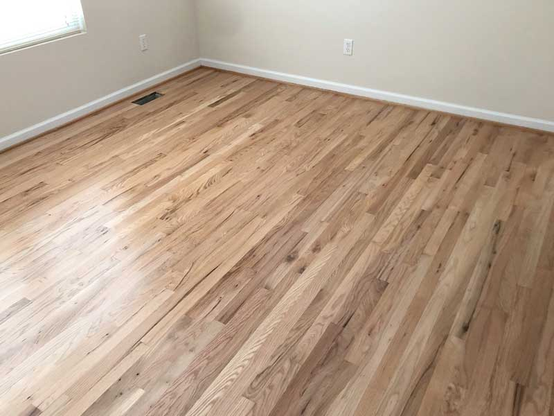 hardwood floor in white room