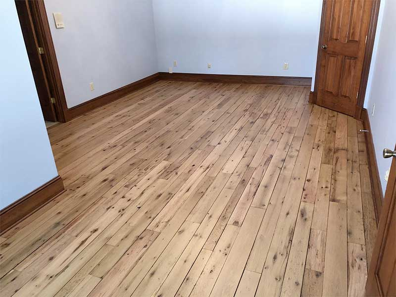 hardwood floor in blue room
